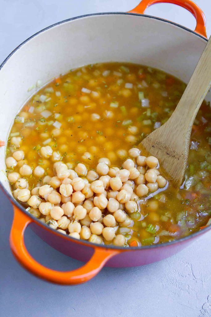 Chickpeas and vegetable broth in a large saucepan