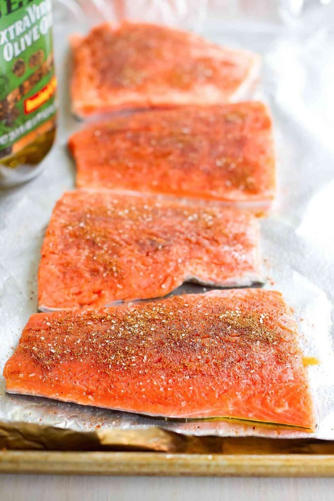 Salmon fillets rubbed with spices.