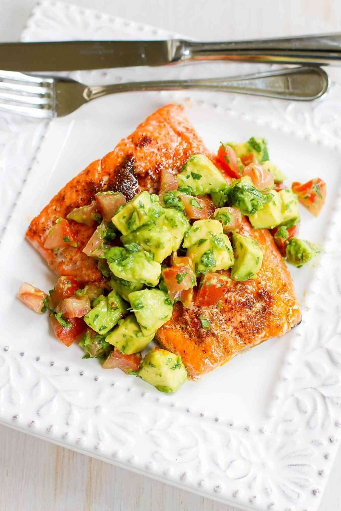 This easy Salmon and Avocado Salsa recipe is Whole30 friendly. A quick spice rub adds tons of flavor to the baked salmon. 345 calories and 3 Weight Watchers  SP | Recipes | Sauce | Dinner | Quick | Whole30 | Seasoning | Whole 30 | Gluten Free | Clean Eating #weightwatchers #cleaneating #whole30 #salmonavocado #salmonrecipes
