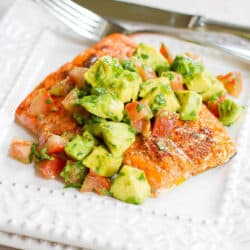 Fillet of roasted salmon topped with avocado salsa
