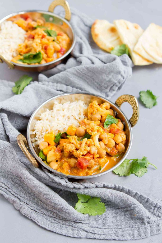 So much flavor in this slow cooker vegetable curry! Chickpeas add a dose of fiber. Serve over rice, with a dollop of mango chutney. 181 calories and 2 Weight Watchers Freestyle SP | Plant Based | Vegetarian | Sweet Potato | Cauliflower | Coconut | Easy | Recipes | Crockpot | Healthy | Spinach and #plantbased #vegancurryrecipes #chickpeacurry #vegetablecurry #weightwatchers #smartpoints