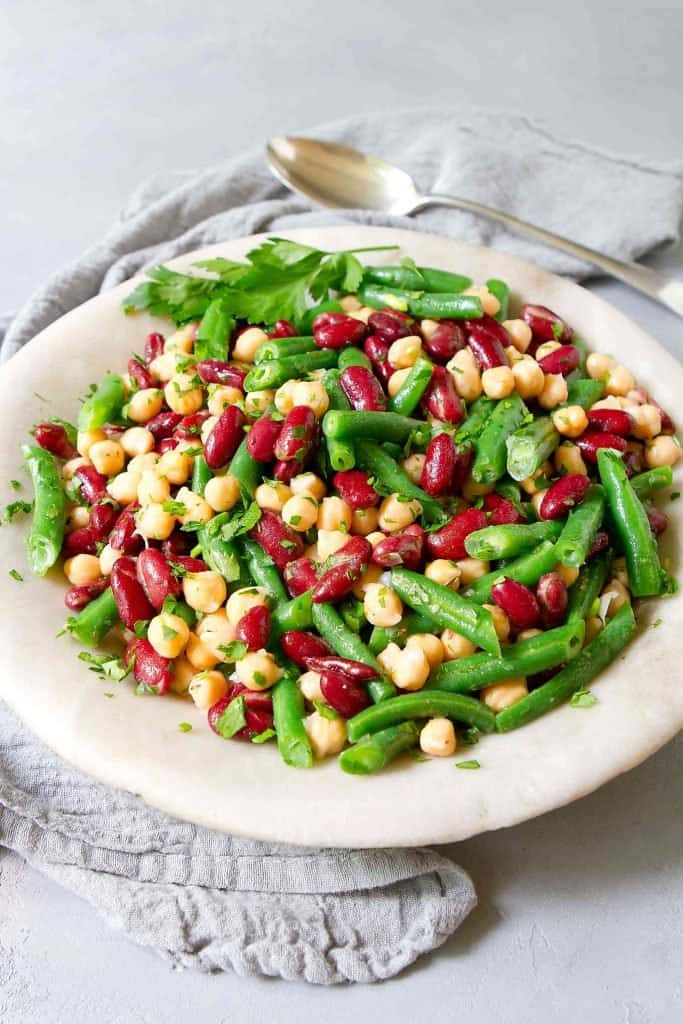 Three Bean Salad is a classic for a reason - it's easy, healthy and delicious! Packed with fiber and tossed with a bright lemon dressing. 201 calories and 2 Weight Watchers | Plant Based | Vegan | Vegetarian | Recipe simple | Recipe healthy | Traditional | Gut Health #plantbased #guthealth #threebeansalad #beansalad #weightwatchers #smartpoints