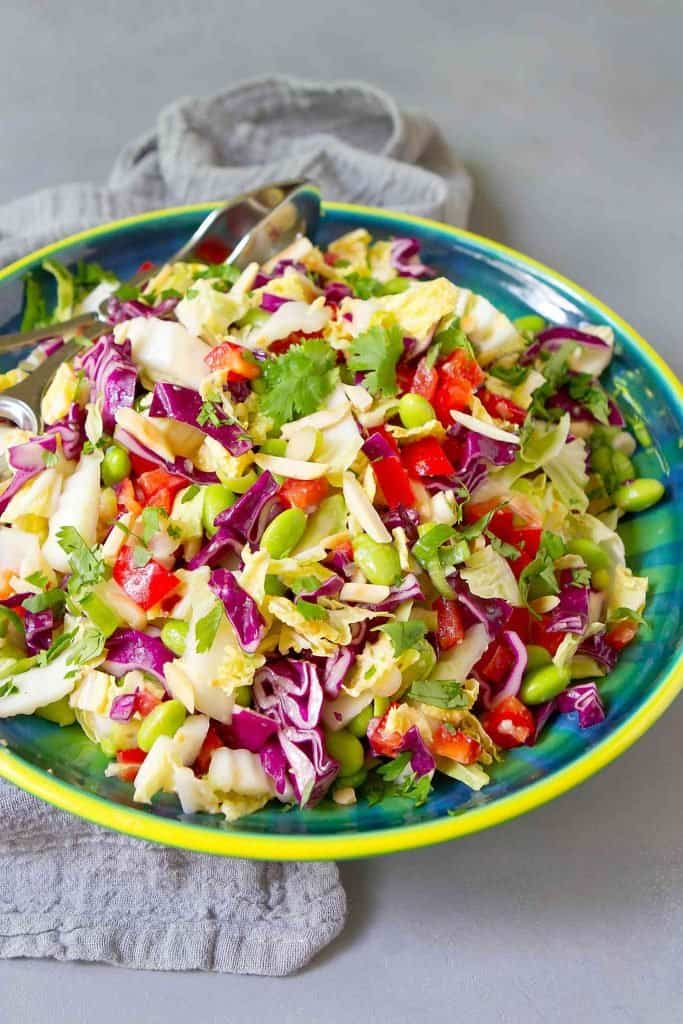 Pile this Asian Slaw on tacos or eat it straight. Tons of veggies, a hit of protein from the edamame and tons of flavor, thanks to the creamy (dairy free) miso dressing. 78 calories and 1 Weight Watchers SP | Recipe easy | Salad | Plant Based | Vegan | Gut Health | Dressing recipe #slawrecipes #asianslaw #edamamerecipes #veganslaw #plantbased #weightwatchers #guthealth
