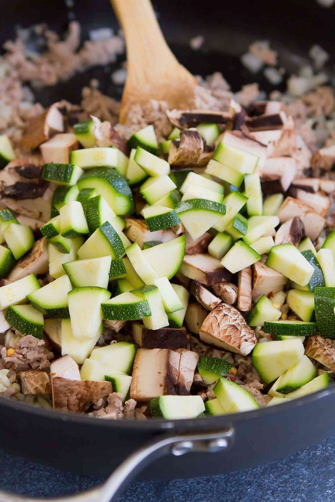 Chopped zucchini and mushrooms in a nonstick skillet