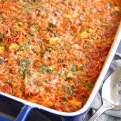 Turkey, zucchini and rice casserole in a dark blue rectangular casserole dish.