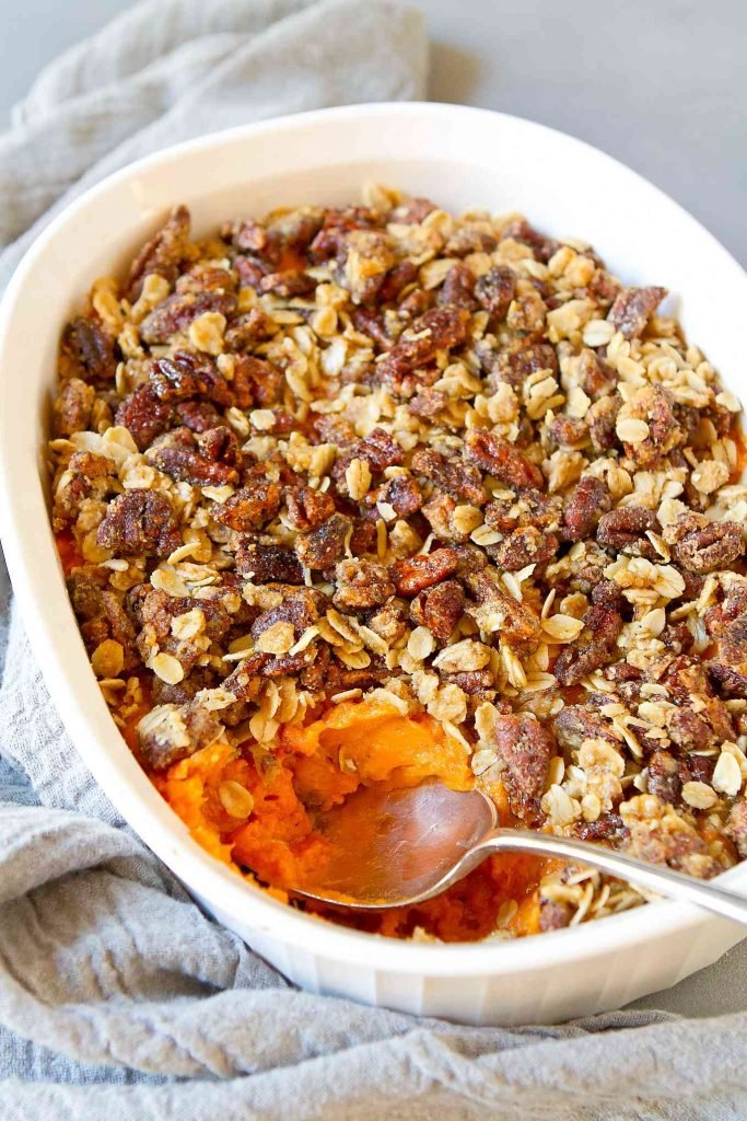 Healthy sweet potato casserole just got a makeover with an amazing chipotle maple pecan topping. Don't miss out on this one! It also happens to be vegan (with non-vegan option included). 304 calories and 9 Weight Watchers SP | With pecans | Plant Based | Vegan | Dairy free | Without marshmallows | Easy | Thanksgiving | Recipes | Savory #sweetpotatocasserole #sidedishes #thanksgivingrecipes #vegansides #veganthanksgiving