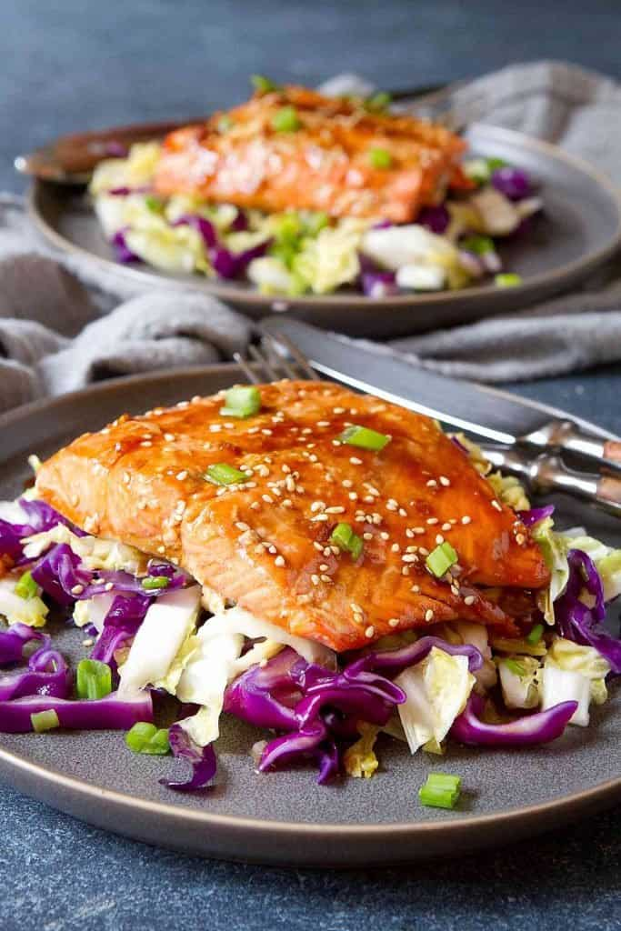 Baked teriyaki salmon in under 30 minutes! This easy and lower sugar teriyaki recipe is served over a delicious, ginger and garlic-flavored cabbage stir-fry. 329 calories and 3 Weight Watchers SP | Baked | Recipes | Healthy | Baked easy | Recipes baked #teriyakisalmon #teriyakirecipes #salmonrecipes #weightwatchers #lowsugar