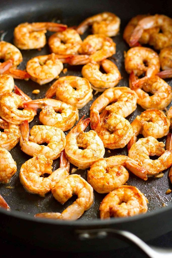 Shrimp cooking in a single layer in a large nonstick skillet