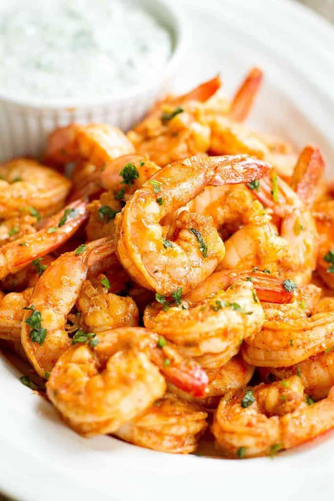 Chili Lime Shrimp is a fantastic easy appetizer, but can also be served as part of a light dinner! Dip them into the savory cilantro yogurt sauce. 87 calories and 1 Weight Watchers SP | Appetizers | Quick | Finger food | Healthy #shrimprecipes #shrimpappetizer #healthyappetizers #easyappetizers #weightwatchers