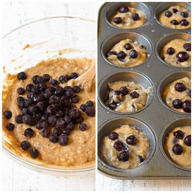 Blueberries in batter and raw muffins in baking tin.