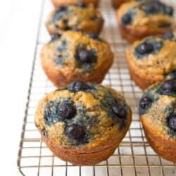 Banana blueberry muffins on a wire rack