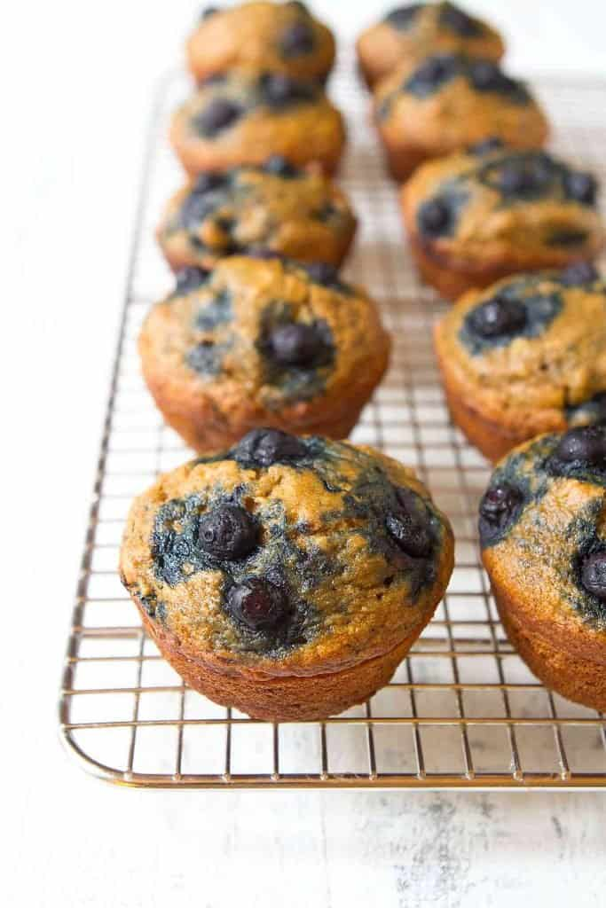 These banana blueberry muffins are bursting with fruit and spices. Tender and moist, you would never guess that they were healthy! 134 calories and 4 Weight Watchers SP | Healthy | Easy | Moist | Whole wheat | Oil free #bananablueberrymuffins #blueberrymuffins #bananamuffins #healthymuffins #weightwatchers