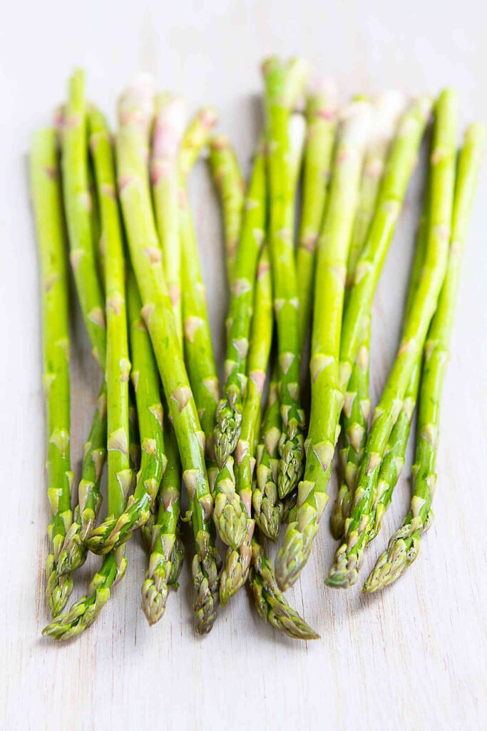 Asparagus spears on a white background.