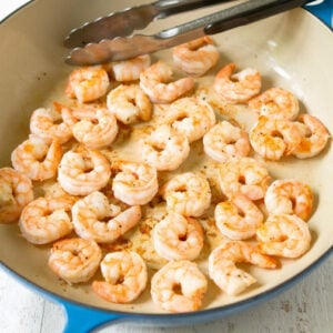 Cooked shrimp in a large skillet.