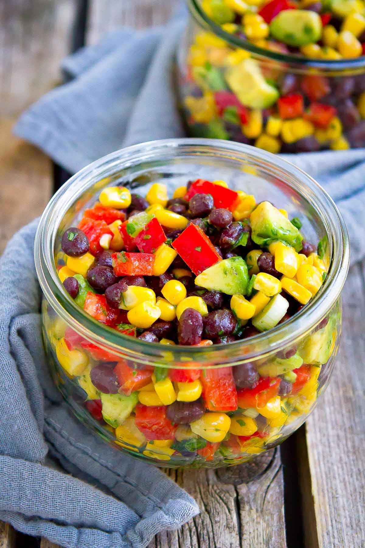 10 minute recipe! Once you taste this fresh and flavorful Black Bean and Corn Salad, you'll want to serve it at every summertime barbecue and picnic. | Easy | Vegan | Plant Based | Dressing | Healthy