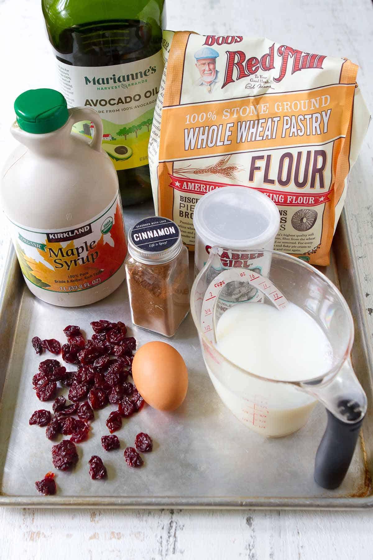 Ingredients for mug pancakes on a baking sheet.