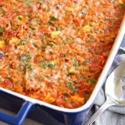 Turkey, zucchini and rice casserole in a blue baking dish.
