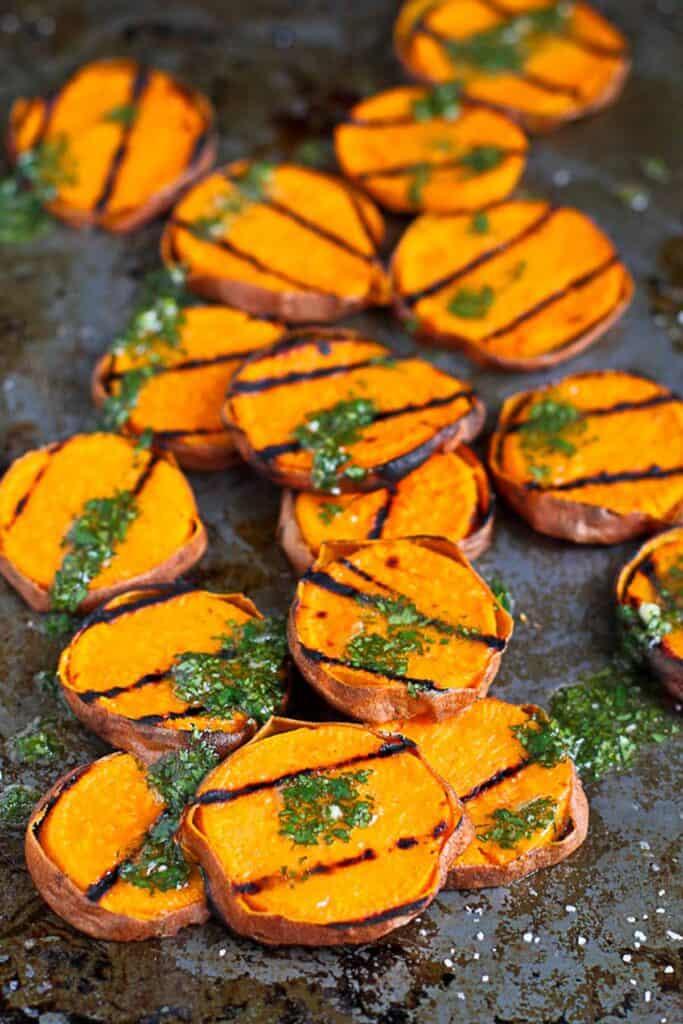 Grilled sweet potato slices with dots of cilantro vinaigrette.